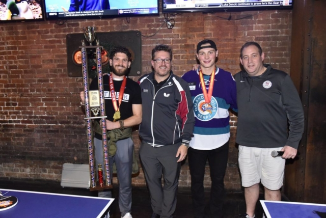 Jason Siegel presents Dillon Powers with first place trophy for Pong on the Plaza Orlando Celebrity Table Tennis Tournament